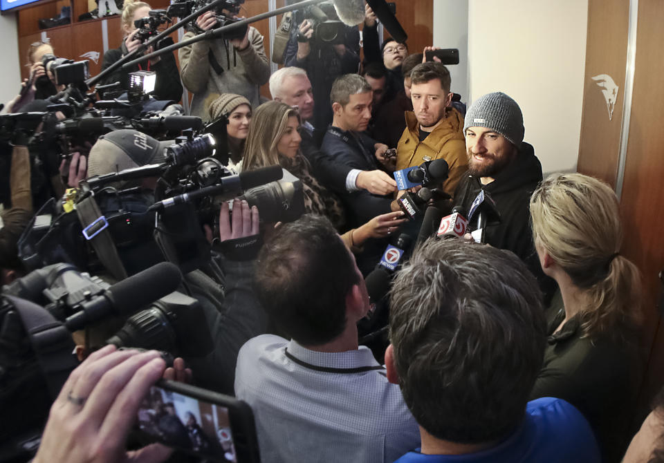 Scenes like this 2020 playoffs media scrum in the New England Patriots locker room wont exist in 2021. (Matthew J. Lee/The Boston Globe via Getty Images)