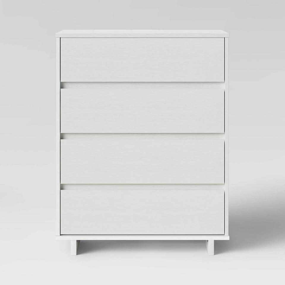<p>Get this <span>Room Essentials Modern 4 Drawer Dresser</span> ($120) to store all your clothes.</p>