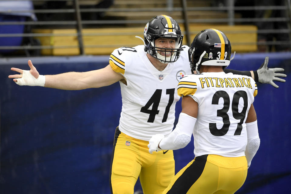 The Steelers' defense, including linebacker Robert Spillane (left) and safety Minkah Fitzpatrick, led the way in a big win over the Ravens. (AP Photo/Nick Wass)