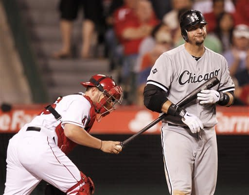 Chicago White Sox's A.J. Pierzynski, right, reacts after striking out as Los Angeles Angels catcher Bobby Wilson heads to the dugout after the middle of the eighth inning of a baseball game in Anaheim, Calif., Wednesday, May 16, 2012. (AP Photo/Chris Carlson)