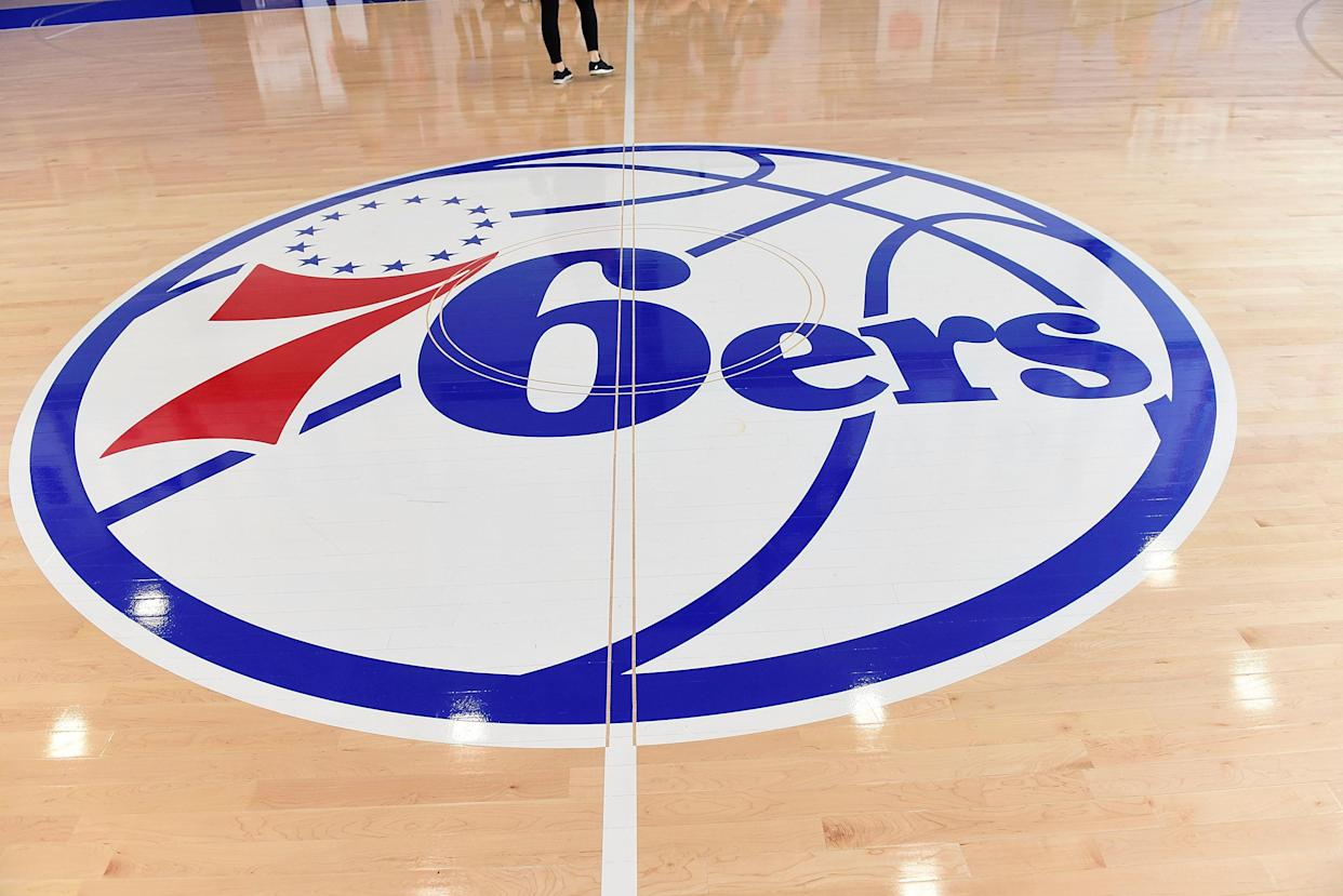 CAMDEN, NJ - SEPTEMBER 09:  Interior of 76ers logo painted on wooden floor at Sixers Training Complex in Camden, New Jersey during the Julius Erving Youth Basketball Clinic  on September 9, 2017  (Photo by Lisa Lake/Getty Images for PGD Global)