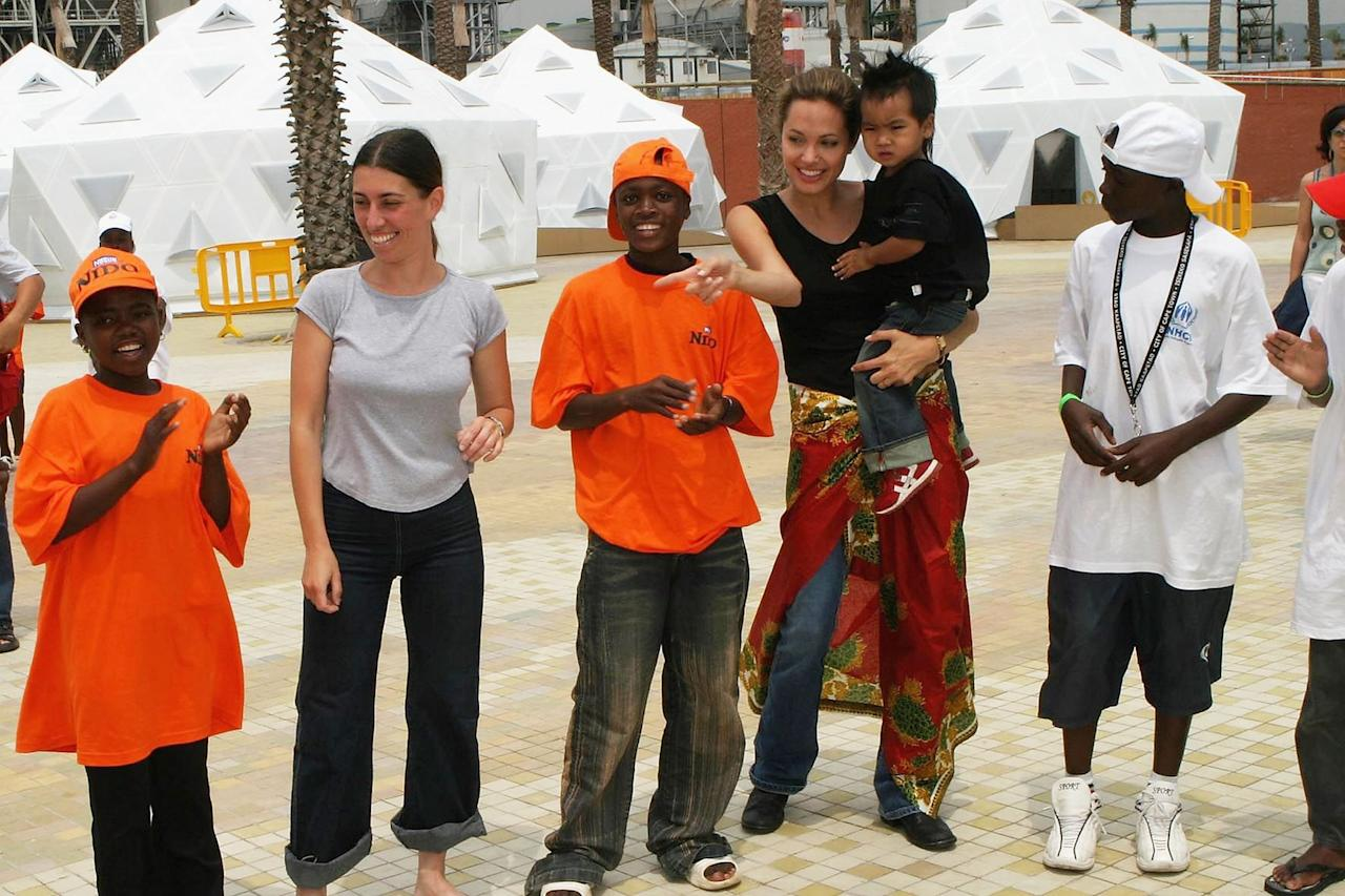 <p>Angelina traveled to Spain with Maddox for World Refugee Day in 2004. </p>