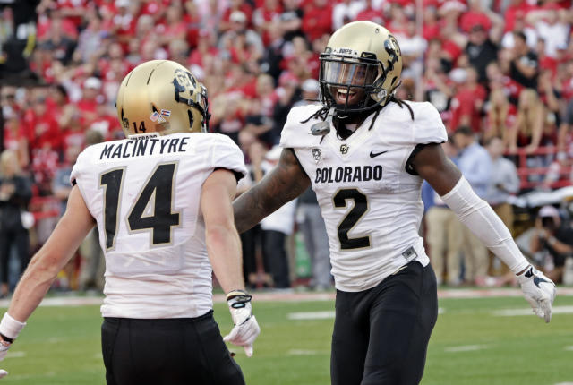 Colorado wide receiver Laviska Shenault Jr. (2) celebrates with wide receiver Jay MacIntyre (14) after he caught the go-ahead touchdown against Nebraska during the second half of an NCAA college football game in Lincoln, Neb., Saturday, Sept. 8, 2018. Colorado won 33-28. (AP Photo/Nati Harnik)