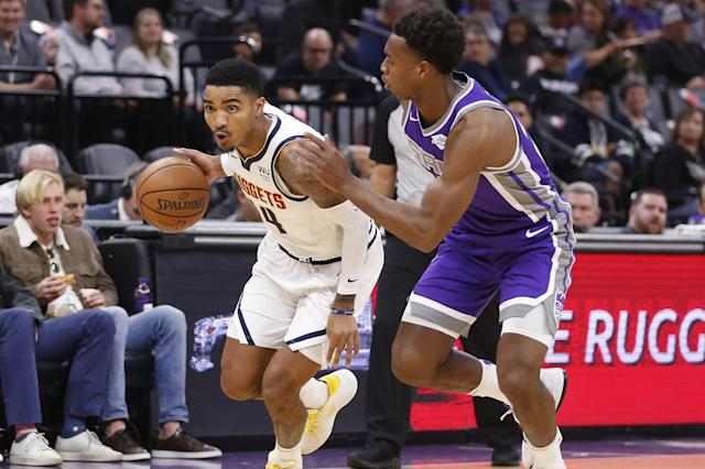 Denver Nuggets guard Gary Harris, left, drives to the basket against Sacramento Kings guard Buddy Hield during the first quarter of an NBA basketball game in Sacramento, Calif., Monday, Oct. 28, 2019. (AP Photo/Rich Pedroncelli)