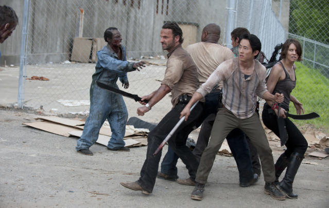 "Rick Grimes (Andrew Lincoln), T-Dog (Robert 'IronE' Singleton), Daryl Dixon (Norman Reedus), Glenn (Steven Yeun) and Maggie Greene (Lauren Cohan) in ""Seed,"" the Season Three premiere episode of ""The Walking Dead"" on AMC."