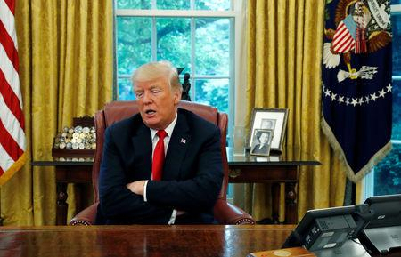 U.S. President Trump answers question during interview with Reuters in Oval Office of White House in Washington