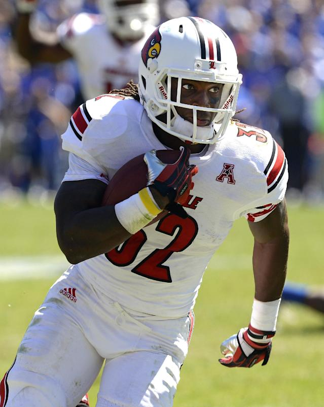 Louisville's Senorise Perry turns upfield for a long gain during the third quarter of an NCAA college football game against Kentucky, Saturday, Sept. 14, 2013, at Commonwealth Stadium in Lexington, Ky. Louisville won 27-13. (AP Photo/Timothy D. Easley)