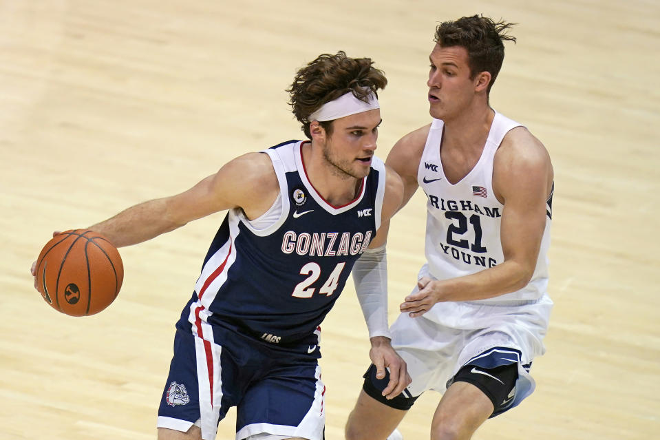 BYU guard Trevin Knell (21) guards Gonzaga forward Corey Kispert (24) in the second half of an NCAA college basketball game, Monday, Feb. 8, 2021, in Provo, Utah. (AP Photo/Rick Bowmer)