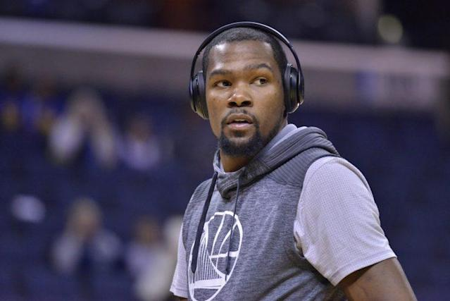 "<a class=""link rapid-noclick-resp"" href=""/nba/players/4244/"" data-ylk=""slk:Kevin Durant"">Kevin Durant</a> has tuned out the noise and turned up the Warriors. (AP)"