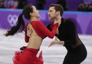 <p>Yura Min and Alexander Gamelin of South Korea perform during the ice dance short dance team event in the Gangneung Ice Arena at the 2018 Winter Olympics in Gangneung, South Korea, Sunday, Feb. 11, 2018. (AP Photo/Julie Jacobson) </p>