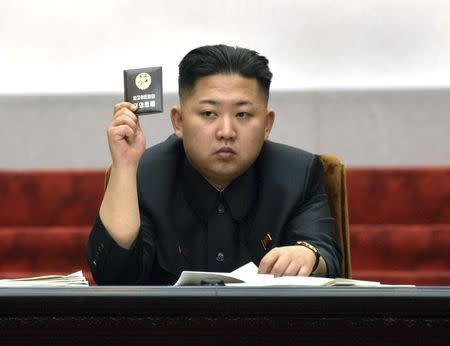 North Korean leader Kim Jong-Un holds up his ballot during the fifth session of the 12th Supreme People's Assembly of North Korea at the Mansudae Assembly Hall in Pyongyang in this April 13, 2012 file photo released by the North's KCNA on April 14, 2012. REUTERS/KCNA