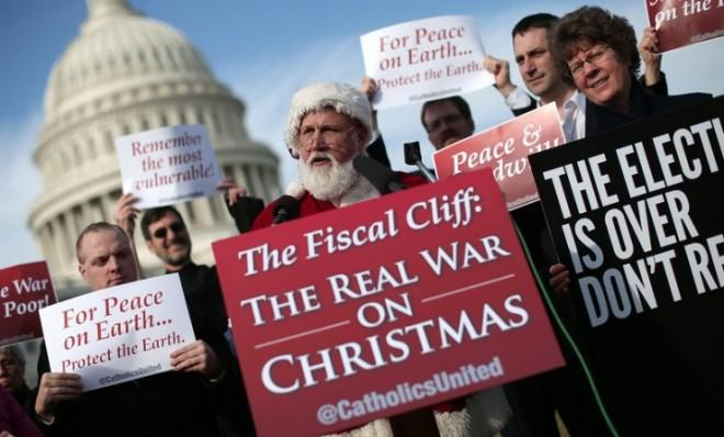 A man dressed as Santa Claus speaks outside the U.S. Capitol before making his way to House Speaker John Boehner's office on Dec. 12.
