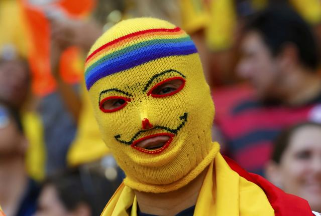 A Colombia fan wearing a balaclava is seen before the team's 2014 World Cup Group C soccer match against Ivory Coast at the Brasilia national stadium in Brasilia June 19, 2014. REUTERS/Paul Hanna (BRAZIL - Tags: SOCIETY SOCCER SPORT TPX IMAGES OF THE DAY WORLD CUP)