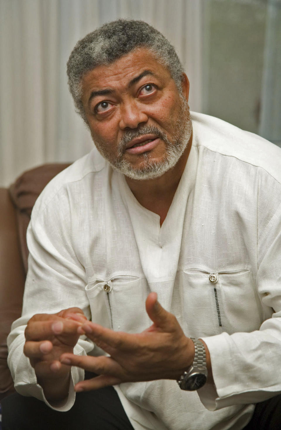 FILE - In this Monday, March 5, 2007 file photo, former Ghanaian coup leader and president Jerry Rawlings is seen during a press interview in Accra, Ghana. Ghana's former president Jerry Rawlings, who staged two coups and later led the West African country's transition to a stable democracy, has died aged 73, according to the state's Radio Ghana and the president Thursday, Nov. 12, 2020. (AP Photo/Olivier Asselin, File)