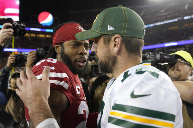 FILE - In this Nov. 24, 2019, file photo, San Francisco 49ers cornerback Richard Sherman, left, greets Green Bay Packers quarterback Aaron Rodgers after an NFL football game in Santa Clara, Calif. Two of the best at their jobs will meet once again in the NFC championship game when Green Bay quarterback Aaron Rodgers must decide how much to challenge San Francisco cornerback Richard Sherman. (AP Photo/Tony Avelar, File)