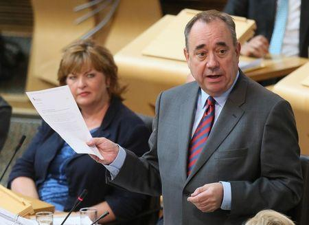 Scotland's First Minister, Alex Salmond, addresses Members of the Scottish Parliament, during First Minister's Question Time, in Edinburgh