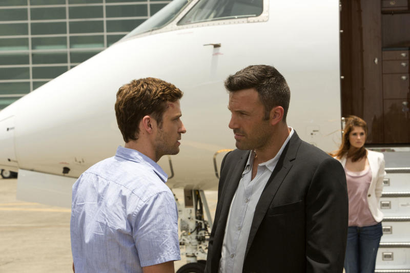"This image released by 20th Century Fox shows Justin Timberlake, left, and Ben Affleck in a scene from ""Runner Runner."" (AP Photo/20th Century Fox, Scott Garfield)"