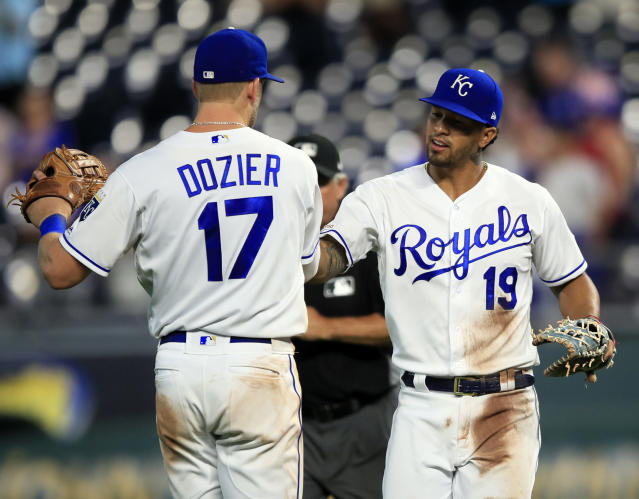 Kansas City Royals first baseman Cheslor Cuthbert (19) and third baseman Hunter Dozier (17) celebrate following a baseball game against the Chicago White Sox at Kauffman Stadium in Kansas City, Mo., Monday, July 15, 2019. (AP Photo/Orlin Wagner)