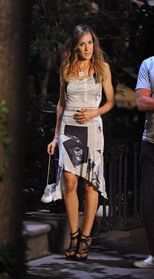 """7. Carrie first rocks this newsworthy newsprint dress in Season 3 when she apologizes to Natasha for having an affair with Big. She dons the John Galliano for Christian Dior dress again in """"Sex and the City 2,"""" but you'll have to see the movie to find out when and where she wears it!"""