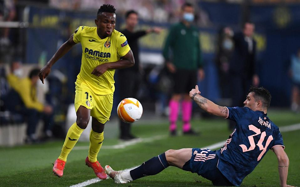 Samuel Chukwueze of Villarreal is challenged by GranitXhaka of Arsenal during the UEFA Europa League Semi-final First Leg match between Villareal CF and Arsenal - Getty Images