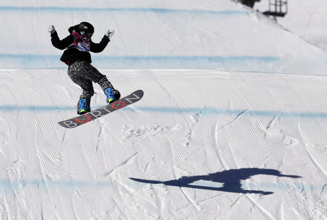 Finland's Peetu Piiroinen lands from a jump during the men's snowboard slopestyle final at the Rosa Khutor Extreme Park, at the 2014 Winter Olympics, Saturday, Feb. 8, 2014, in Krasnaya Polyana, Russia. (AP Photo/Andy Wong)