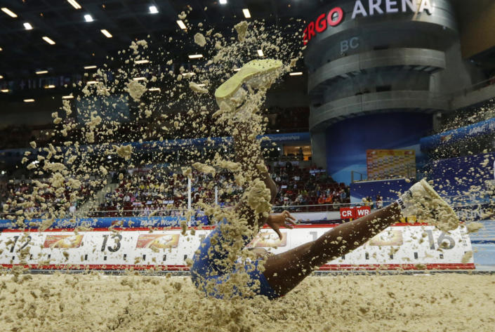 Cuba's Yarianna Martinez makes an attempt in the qualification for the women's triple jump during the Athletics Indoor World Championships in Sopot, Poland, Friday, March 7, 2014. (AP Photo/Matt Dunham)