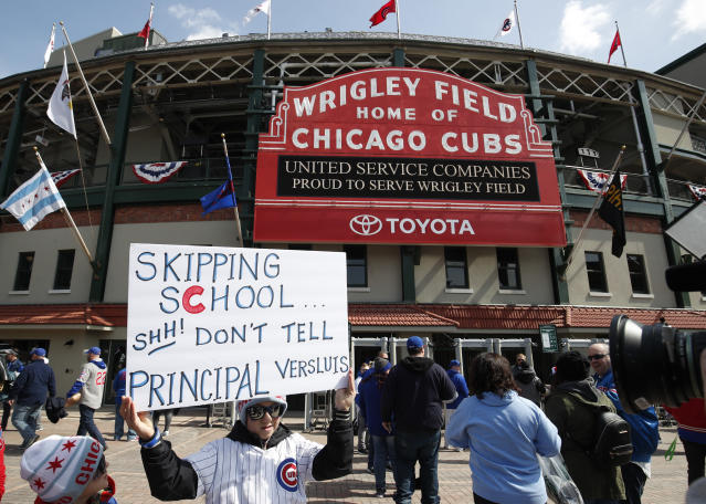 A young Cubs fan who skipped school happened to run into his principal at the game. (AP Photo)