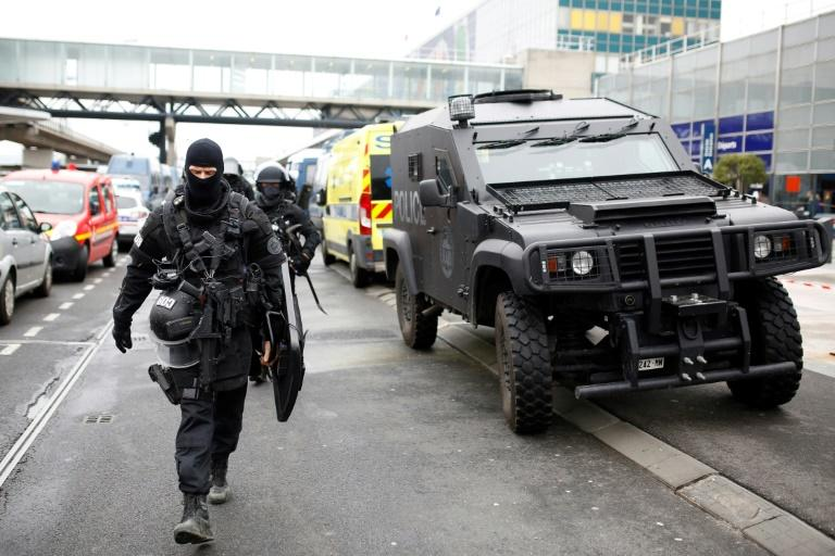 Police officers secure the area at Paris' Orly airport on March 18, 2017, after a man was shot dead when he tried to grab an officer's weapon