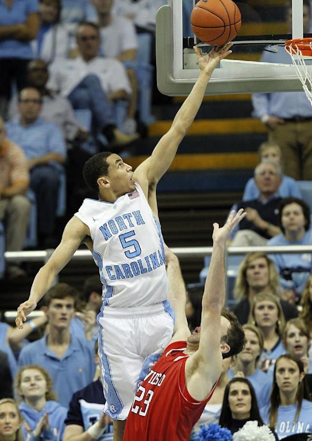 North Carolina's Marcus Paige (5) goes to the basket against Davidson's Tom Droney, right, during the second half of an NCAA college basketball game in Chapel Hill, N.C., Saturday, Dec. 21, 2013. North Carolina won 97-85 in overtime. (AP Photo/Ellen Ozier)