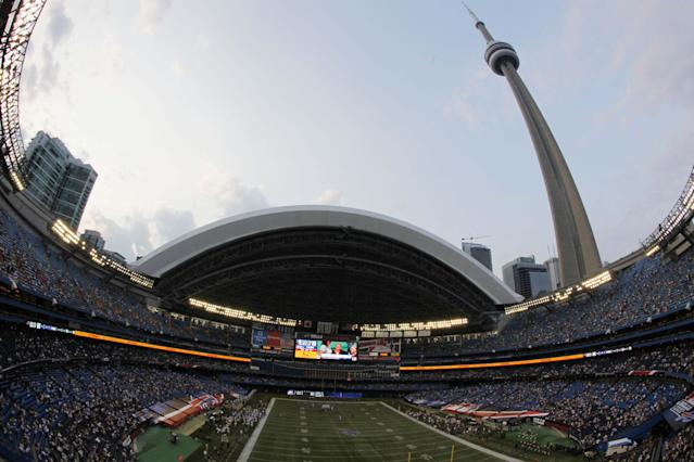FILE- In this Aug. 19, 2010 file photo taken with a fish-eye lens, the Indianapolis Colts play the Buffalo Bills in the first quarter of an NFL preseason football game at the Rogers Centre in Toronto. Considered a home game for the Bills, the team will travel to Toronto for a Dec. 1, 2013 game against the Atlanta Falcons. (AP Photo/ Dean Duprey, File)