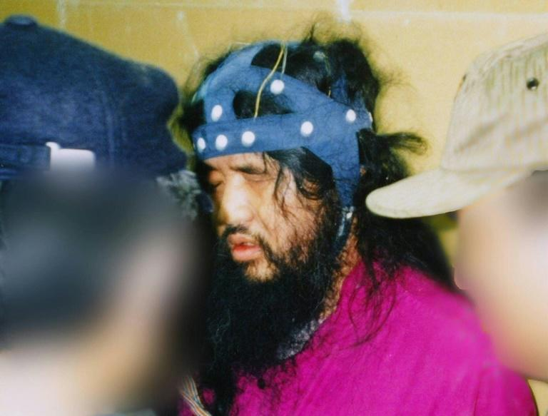 Doomsday cult leader Shoko Asahara (pictured during his arrest in 1995) was exectuted last week over the gas attack on the Tokyo subway that killed 13 people