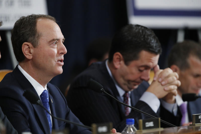 House Intelligence Committee Chairman Adam Schiff, D-Calif., left, questions U.S. Ambassador to the European Union Gordon Sondland testifies before the House Intelligence Committee on Capitol Hill in Washington, Wednesday, Nov. 20, 2019, during a public impeachment hearing of President Donald Trump's efforts to tie U.S. aid for Ukraine to investigations of his political opponents, as ranking member Rep. Devin Nunes of Calif., looks on. (AP Photo/Alex Brandon)