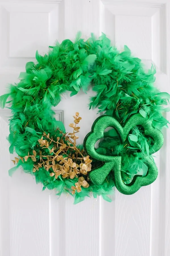 "<p>Using a funky feather boa as the basis for this Paddy's Day wreath decreases the cost and increases the fun.</p><p><strong>Get the tutorial at <a href=""https://joyfulderivatives.com/diy-st-patricks-day-wreath/"" rel=""nofollow noopener"" target=""_blank"" data-ylk=""slk:Joyful Derivatives"" class=""link rapid-noclick-resp"">Joyful Derivatives</a>.</strong></p><p><a class=""link rapid-noclick-resp"" href=""https://www.amazon.com/Green-Boa/s?k=Green+Boa&tag=syn-yahoo-20&ascsubtag=%5Bartid%7C10050.g.35162910%5Bsrc%7Cyahoo-us"" rel=""nofollow noopener"" target=""_blank"" data-ylk=""slk:SHOP FEATHER BOAS"">SHOP FEATHER BOAS</a><br></p>"