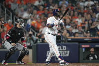 Houston Astros designated hitter Yordan Alvarez watches his ball as he hits a solo home run off Chicago White Sox relief pitcher Reynaldo Lopez during the fifth inning in Game 1 of a baseball American League Division Series Thursday, Oct. 7, 2021, in Houston. White Sox catcher Yasmani Grandal watches the ball as well. (AP Photo/David J. Phillip)