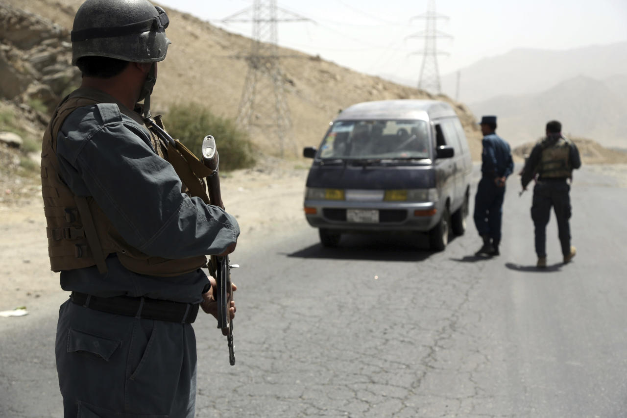 Afghan police officers search a vehicle at a checkpoint on the Ghazni highway, in Maidan Shar, west of Kabul, Afghanistan, Monday, Aug. 13, 2018. A Taliban assault on Ghazni, a key city linking areas of Taliban influence barely 75 miles from Kabul, has killed about 100 Afghan policemen and soldiers since Friday, the Afghan Defense Ministry said. A year after the Trump administration introduced its strategy for Afghanistan, the Taliban are asserting themselves on the battlefield even as U.S. officials talk up hopes for peace. That's raising questions about the viability of the American game plan for ending a war that began when some of the current U.S. troops were in diapers. (AP Photo/Rahmat Gul)