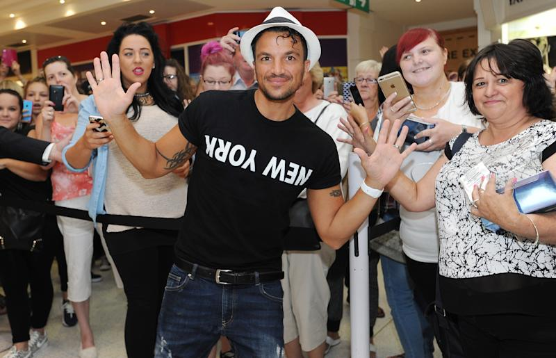 WOKING, ENGLAND - AUGUST 07: Peter Andre meets fans and signs his new fragrance 'Breeze' on August 7, 2015 in Woking, England. (Photo by Tabatha Fireman/Getty Images)