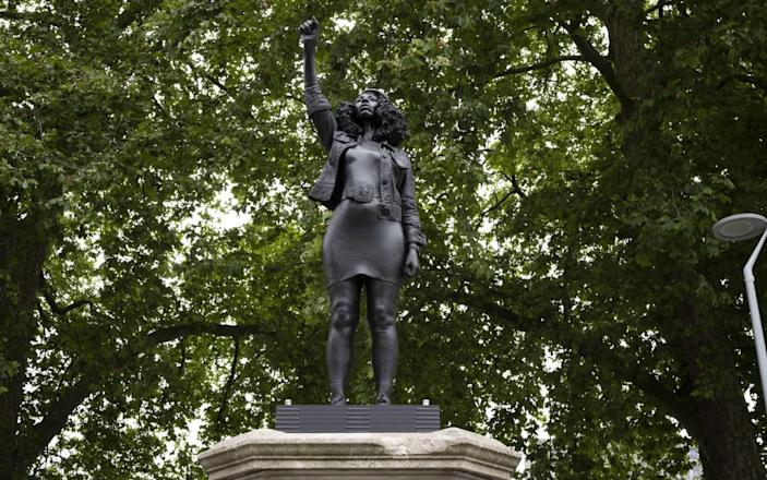 new sculpture, by local artist Marc Quinn, of Black Lives Matter protestor Jen Reid stands on the plinth where the Edward Colston statue used to stand - Getty Images Europe