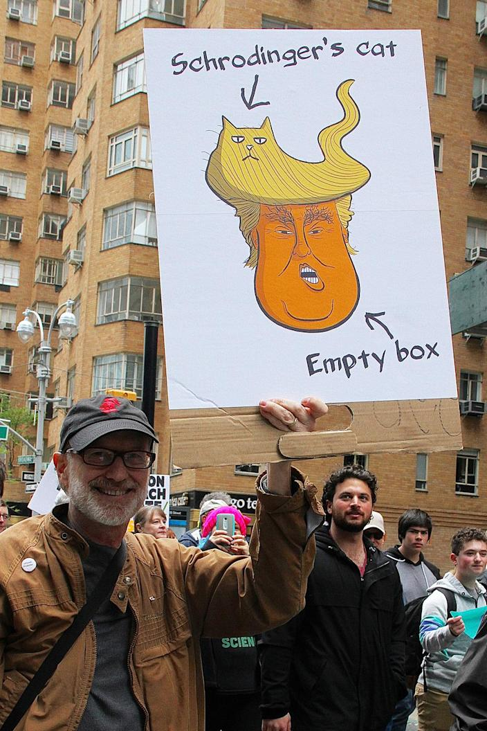 """<p>A man holds a sign during a """"March for Science"""" rally in New York, April 22, 2017. (Photo: Rainmaker Photo/MediaPunch/IPX) </p>"""