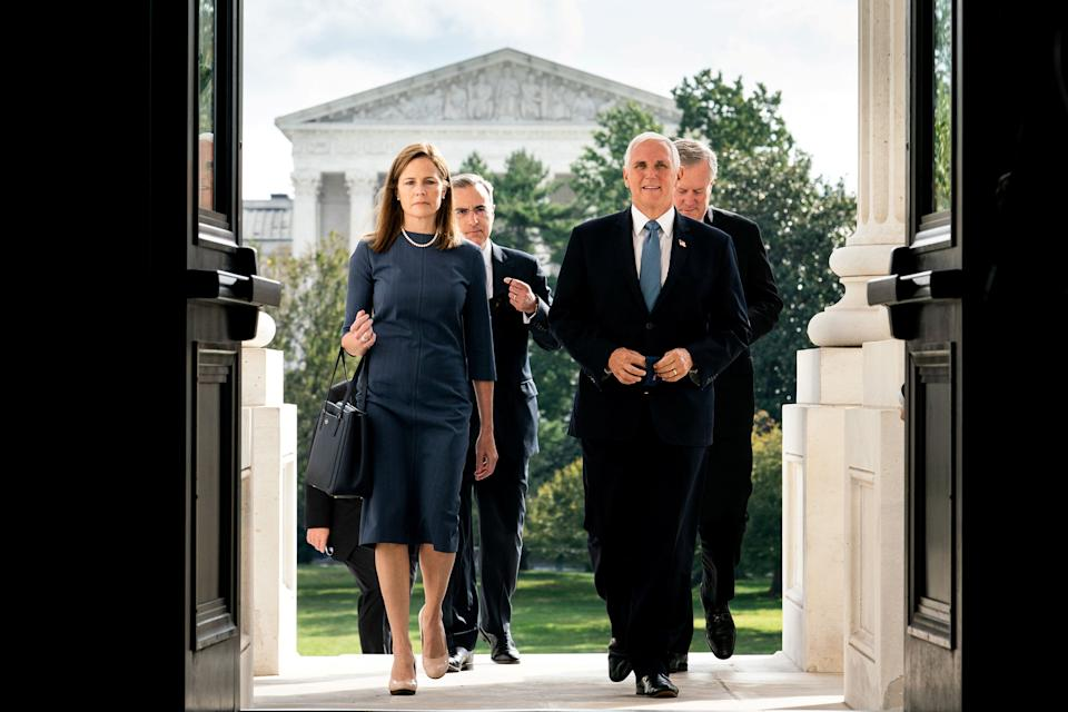 Judge Amy Coney Barrett, U.S. President Donald Trump's nominee to the Supreme Court, and Vice President Mike Pence walk up the steps of the Capitol to meet with Senators, in Washington, DC., U.S., September 29, 2020. Erin Schaff/Pool via REUTERS     TPX IMAGES OF THE DAY (Photo: POOL New / Reuters)