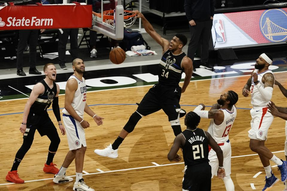 Milwaukee Bucks' Giannis Antetokounmpo dunks during the second half of an NBA basketball game against the LA Clippers Sunday, Feb. 28, 2021, in Milwaukee. The Bucks won 105-100. (AP Photo/Morry Gash)