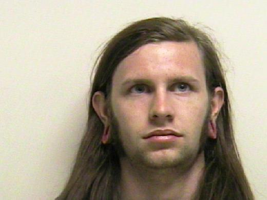 In this photo provided by the Utah County Sheriff's Department showing Kai Christensen, 21, of Provo, who was booked Saturday into the county jail for investigation of misdemeanor reckless endangerment. A Forest Service law enforcement officer with military experience discovered trip wires for the booby traps at entrances of a crude shelter made of dead tree limbs in Provo Canyon, said Utah County sheriff's Sgt. Spencer Cannon. (AP Photo/Utah County Sheriff Department)