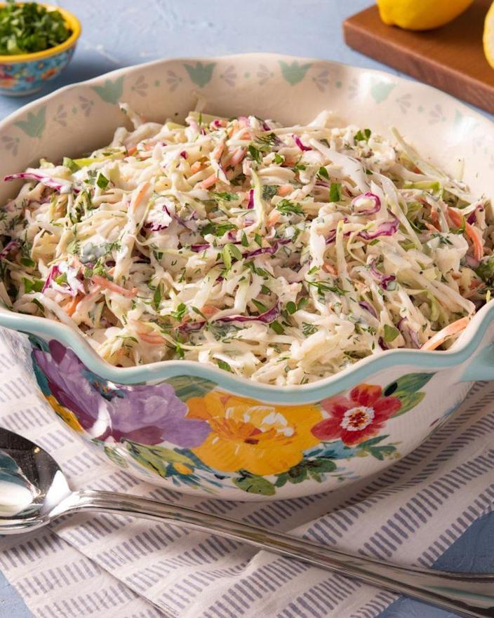 """<p>It's easy to put this classic side dish together, especially when you use pre-shredded cabbage mix. Look for the mix with red and green cabbage, and shredded carrots for color. </p><p><a href=""""https://www.thepioneerwoman.com/food-cooking/recipes/a36303079/coleslaw-recipe/"""" rel=""""nofollow noopener"""" target=""""_blank"""" data-ylk=""""slk:Get the recipe."""" class=""""link rapid-noclick-resp""""><strong>Get the recipe. </strong></a></p><p><a class=""""link rapid-noclick-resp"""" href=""""https://go.redirectingat.com?id=74968X1596630&url=https%3A%2F%2Fwww.walmart.com%2Fsearch%2F%3Fquery%3Dpioneer%2Bwoman%2Bserving%2Bbowls&sref=https%3A%2F%2Fwww.thepioneerwoman.com%2Ffood-cooking%2Fmeals-menus%2Fg36353420%2Ffourth-of-july-side-dishes%2F"""" rel=""""nofollow noopener"""" target=""""_blank"""" data-ylk=""""slk:SHOP SERVING BOWLS"""">SHOP SERVING BOWLS</a></p>"""