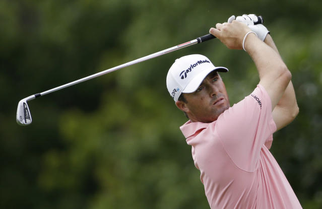 Ryan Palmer watches his tee shot on the eighth hole during the first round of the PGA Championship golf tournament at Valhalla Golf Club on Thursday, Aug. 7, 2014, in Louisville, Ky. (AP Photo/David J. Phillip)