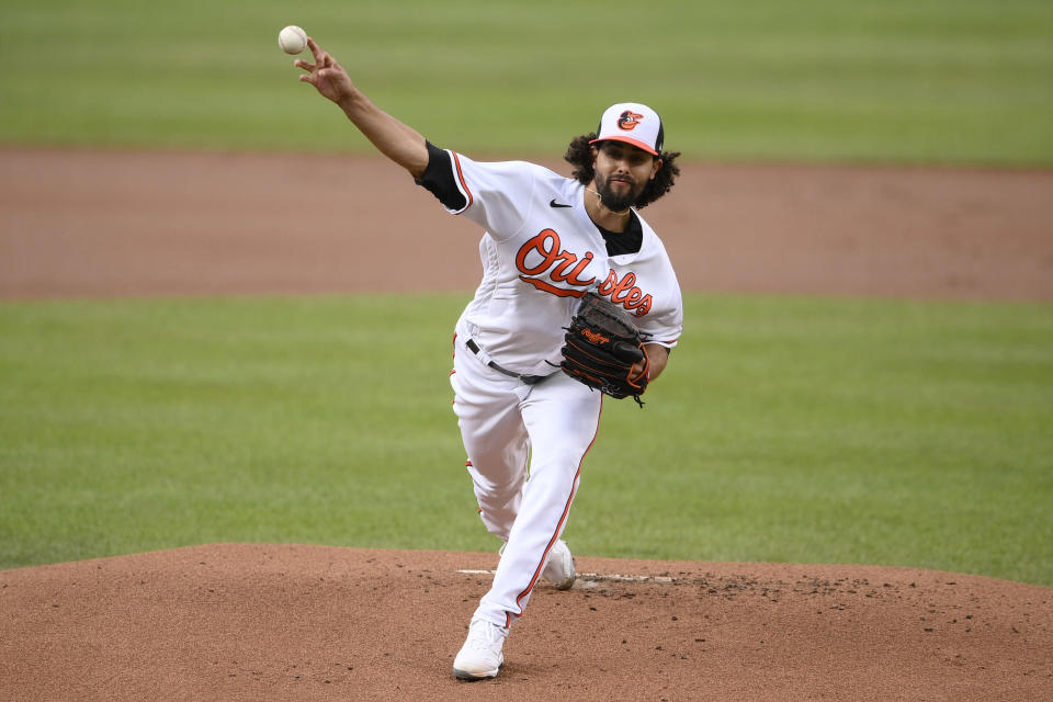 Baltimore Orioles starting pitcher Jorge Lopez delivers the first inning of a baseball game against the Houston Astros, Tuesday, June 22, 2021, in Baltimore. (AP Photo/Nick Wass)