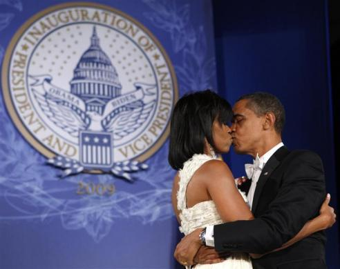 Barack Obama kisses first lady Michelle as they dance at the Eastern Regional Inaugural Ball in Washington January 20, 2009.