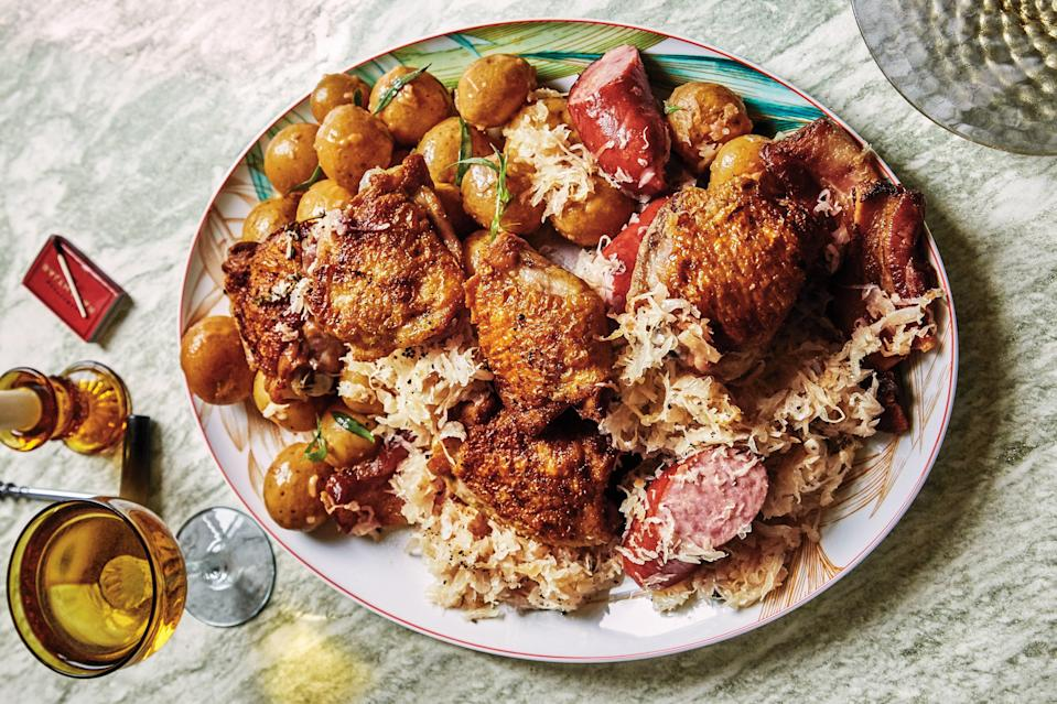 """Creamy boiled potatoes and tart sauerkraut cuts the richness of chicken, sausages, and bacon in this cold-weather favorite. <a href=""""https://www.epicurious.com/recipes/food/views/chicken-and-bacon-choucroute-with-potato-salad?mbid=synd_yahoo_rss"""" rel=""""nofollow noopener"""" target=""""_blank"""" data-ylk=""""slk:See recipe."""" class=""""link rapid-noclick-resp"""">See recipe.</a>"""