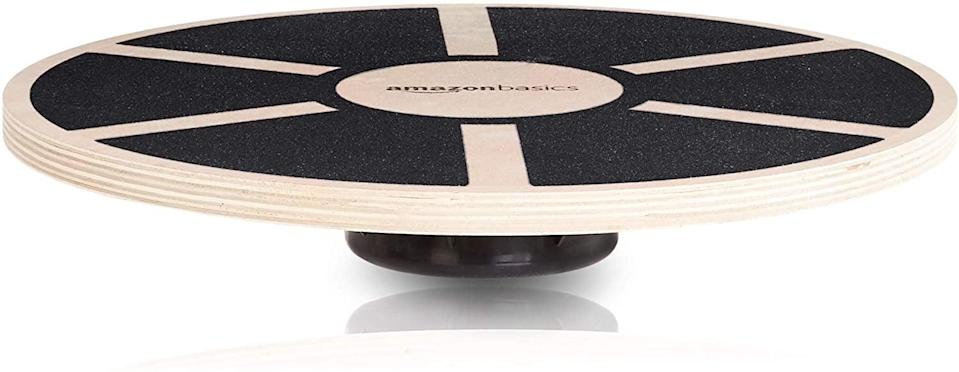 <p>Improve your balance and make your floor work challanging with this <span>Amazon Basics Wood Wobble Balance Board</span> ($20). Work on coordination by doing bodyweight squats on this board. You can also increase the difficulty of your planks and core workouts with this balance board. </p>