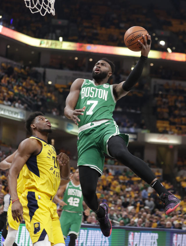 Boston Celtics guard Jaylen Brown (7) shoots over Indiana Pacers forward Thaddeus Young (21) during the first half of Game 4 of an NBA basketball first-round playoff series in Indianapolis, Sunday, April 21, 2019. (AP Photo/Michael Conroy)