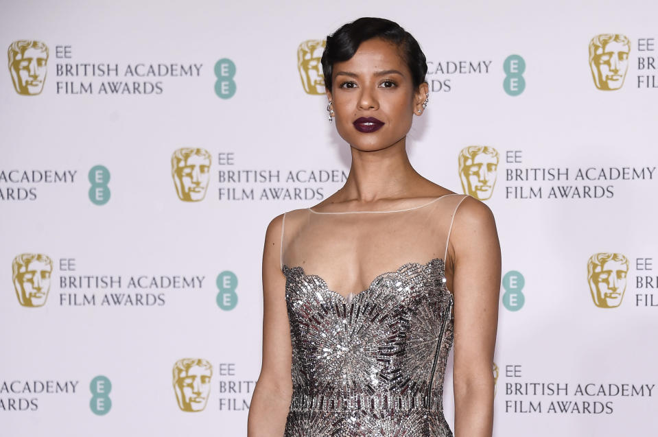 Actress Gugu Mbatha-Raw poses for photographers upon arrival at the Bafta Film Awards, in central London, Sunday, April 11 2021. (AP Photo/Alberto Pezzali)
