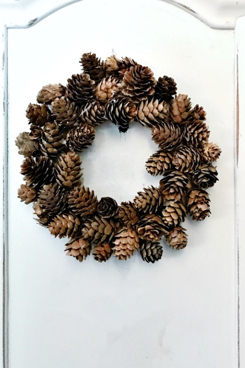 """<p>A simple wooden wreath ring gets all dressed up with craft store pinecones in this easy DIY. If you own a hot glue gun, you're already halfway there.</p><p><strong>Get the tutorial at <a href=""""https://thistlewoodfarms.com/pinecone-wreaths-and-little-moments-like-that/"""" rel=""""nofollow noopener"""" target=""""_blank"""" data-ylk=""""slk:Thistlewood Farms"""" class=""""link rapid-noclick-resp"""">Thistlewood Farms</a>.</strong> </p>"""